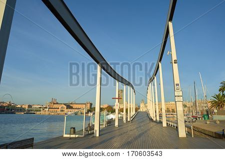 BARCELONA, SPAIN - NOVEMBER 20, 2015: Rambla de Mar in Barcelona in the morning. Barcelona is the capital city of the autonomous community of Catalonia in the Kingdom of Spain.