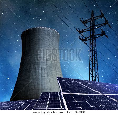Solar energy panels, nuclear power plant and electricity pylon in night.