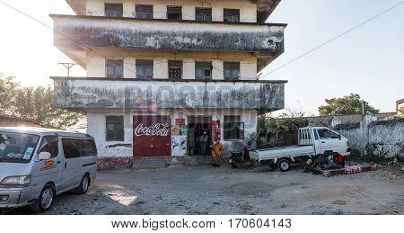 Zanzibar, Tanzania - July 14, 2016: Old building in Zanzibar, Tanzania, vehicles on the background
