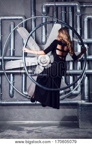 Beautiful blonde in formal black dress