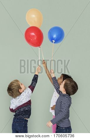 Little Kids Competing Balloons Fun Happy