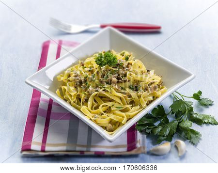 tagliatelle with clam parsley and garlic, selective focus
