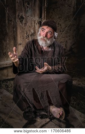 Biblical scene enpicting a beggar in the streets of Jerusalem