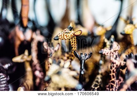 woodcarved giraffe toy at african flea market stall