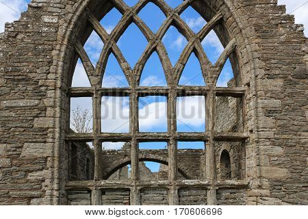 Old St. Peter's Kirk south transcept window with stone transoms and tracery, in Thurso, Scotland, UK