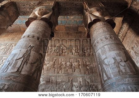 DENDERA TEMPLE, QENA, EGYPT - DECEMBER 05, 2014: Pillars decorated with face of the Egyptian goddess Hathor in Dendera temple