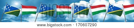 Solomon islands flag with Hungary flag, 3D rendering