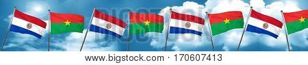 Paraguay flag with Burkina Faso flag, 3D rendering