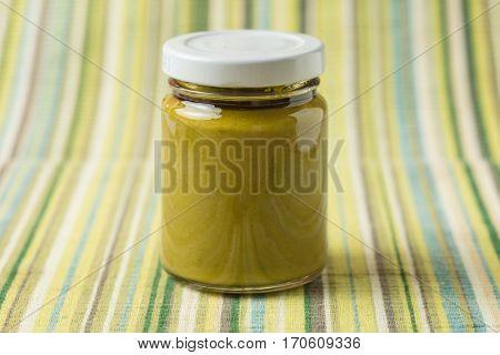 Homemade green pistachio cream in a glass