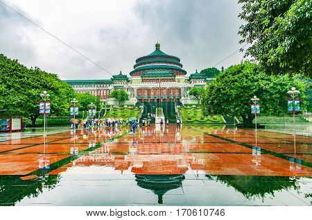 CHONGQING CHINA - September 19 2015: The Great Hall of the People in central of Chongqing was in raining day with tourist raise an umbrella The one of the architectural landmark of Chongqing.