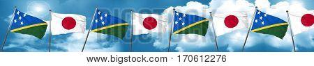 Solomon islands flag with Japan flag, 3D rendering