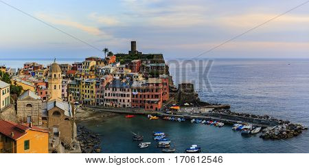 Colorful traditional houses on a rock over Mediterranean sea on  sunset, Vernazza, Cinque Terre, Italy