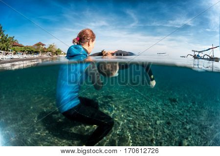 Underwater shot of free divers working out in the tropical sea,