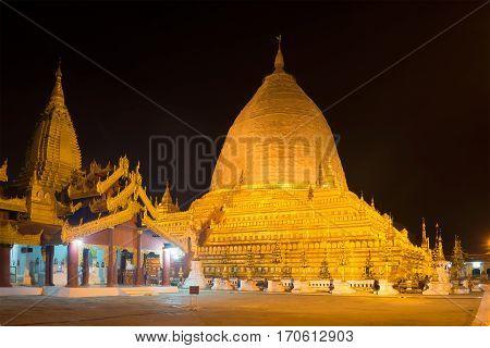 NYAUNG U, MYANMAR - DECEMBER 23, 2016: The old Shwezigon Pagoda in the night