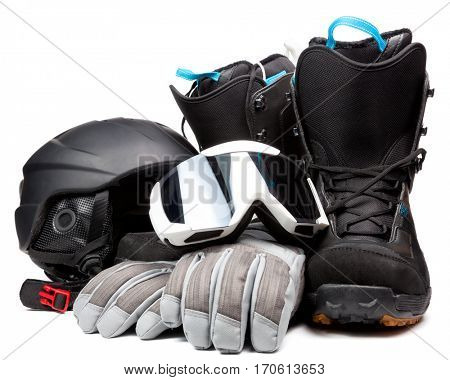 Snowboard boots with mask helmet and gloves on white background