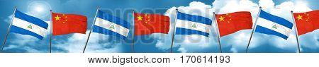 nicaragua flag with China flag, 3D rendering