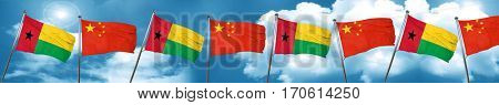 Guinea bissau flag with China flag, 3D rendering