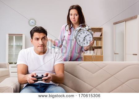 Young family suffering from computer games addiction