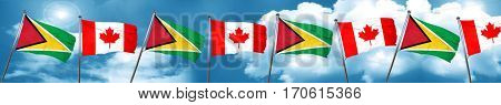 Guyana flag with Canada flag, 3D rendering