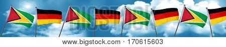 Guyana flag with Germany flag, 3D rendering