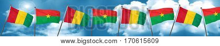 Guinea flag with Burkina Faso flag, 3D rendering
