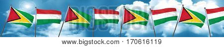 Guyana flag with Hungary flag, 3D rendering