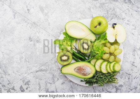 Fresh green vegetables and herbs. Ingredients for the seasonal dishes. The concept of organic natural food. Top view. greenery