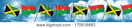 Jamaica flag with Burkina Faso flag, 3D rendering