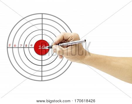 a male's hand holding pen pointing to the bull's eye of a target isolated on white background.
