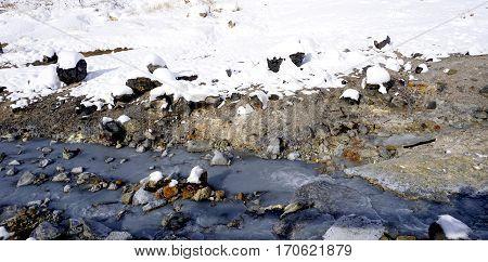 Closeup Snow Stone And Stream In The Mist Noboribetsu Onsen