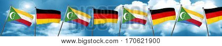 Comoros flag with Germany flag, 3D rendering