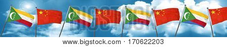 Comoros flag with China flag, 3D rendering