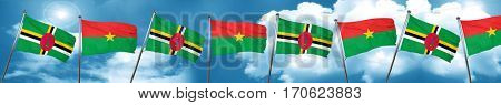 Dominica flag with Burkina Faso flag, 3D rendering