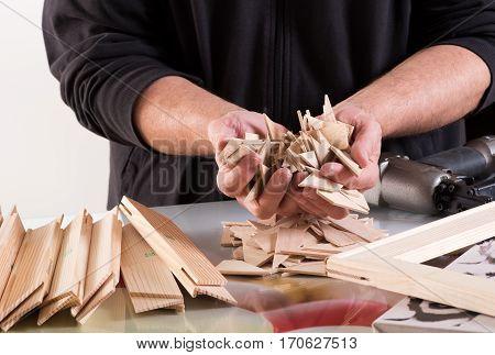 Man Holding Workpieces Of Framework