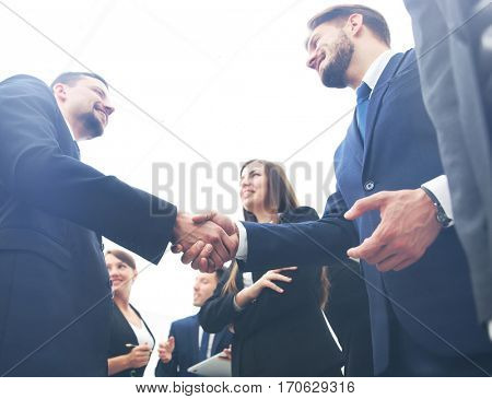Business handshake. Business handshake and business people conce
