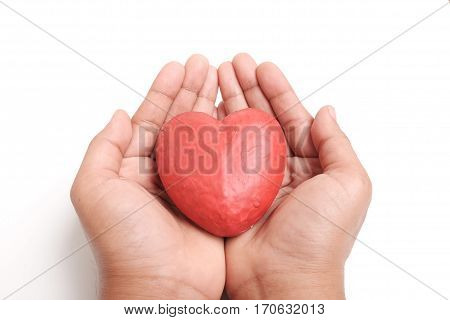 Hand holding red heart; Give heart, Valentine's day, Health care, Love and Hope concept.