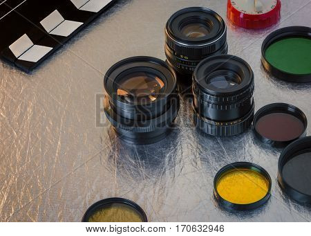 Clapperboard lenses and filters on the table