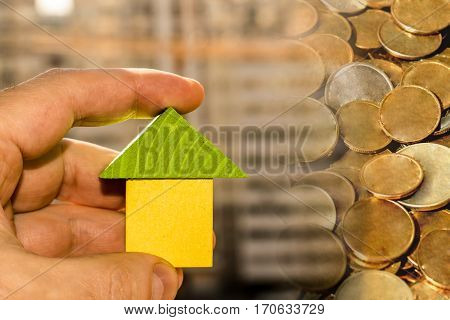 The facade of a residential high-rise house on a background of money . The concept of investment in share construction