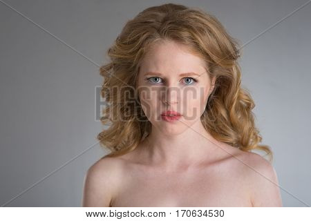 young woman face portrait  on grey background