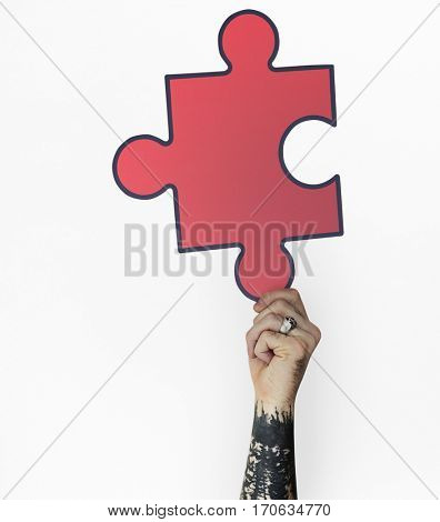 Human Hand Holding Jigsaw Puzzle