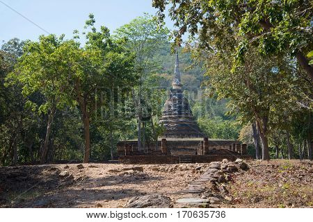 A view of the ruins of ancient buddhist temple Wat Chedi Ngarm. Neighborhood of Sukhothai city Thailand