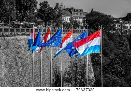 Waving Flags Of Luxemburg And The European Union
