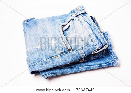 Blue jeans closeup on white background texture of denim