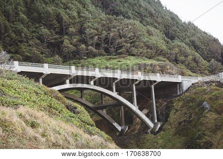 Stone bridge on Oregon coast on the Pacific Coast Highway. Summer spring or fall day setting.