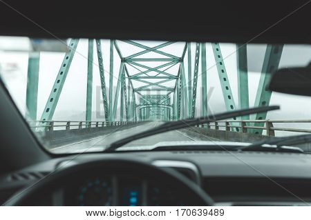 Driver's seat perspective inside vehicle driving on an extended bridge near Astoria Oregon and Long Beach Washington.