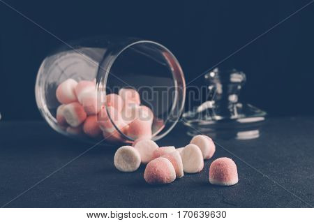 Pink Candies In A Jar On A Dark Background