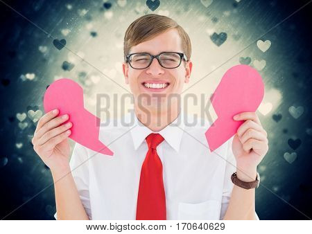 Crying man holding broken heart with heart shapes on background