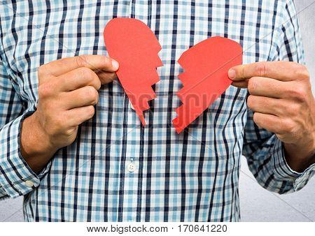 Mid section of man holding broken heart