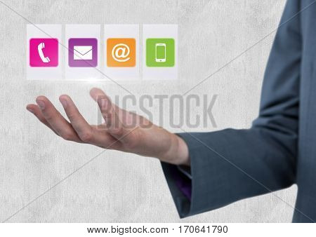 Close-up of hand with digitally generated icon against white background
