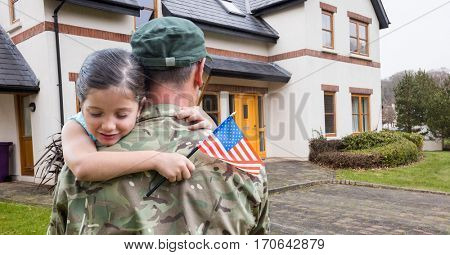Composite images of American soldier carrying girl in front of a house